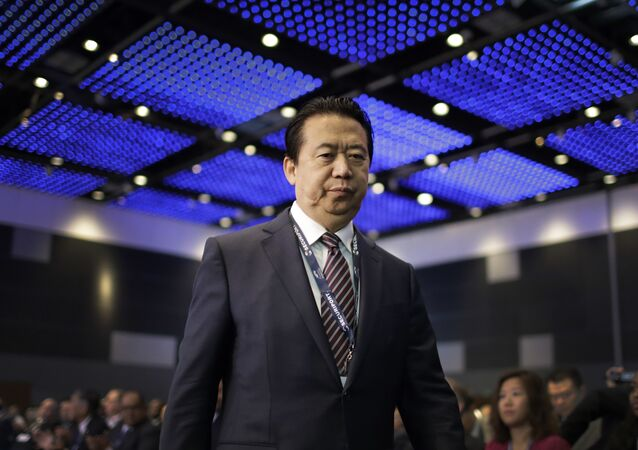 Interpol President, Meng Hongwei, walks towards the stage to deliver his opening address at the Interpol World congress on Tuesday, July 4, 2017, in Singapore