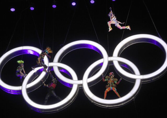 Actors perform high up in the air, inside the Olympic rings during the Opening Ceremony of The Youth Olympic Games, in Buenos Aires, Argentina, Saturday, Oct. 6, 2018.