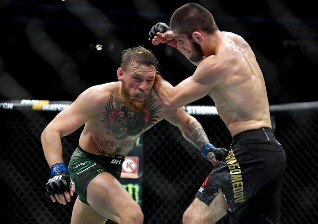 Khabib Nurmagomedov (red gloves) fights Conor McGregor (blue gloves) during UFC 229 at T-Mobile Arena in Las Vegas, Oct. 6, 2018