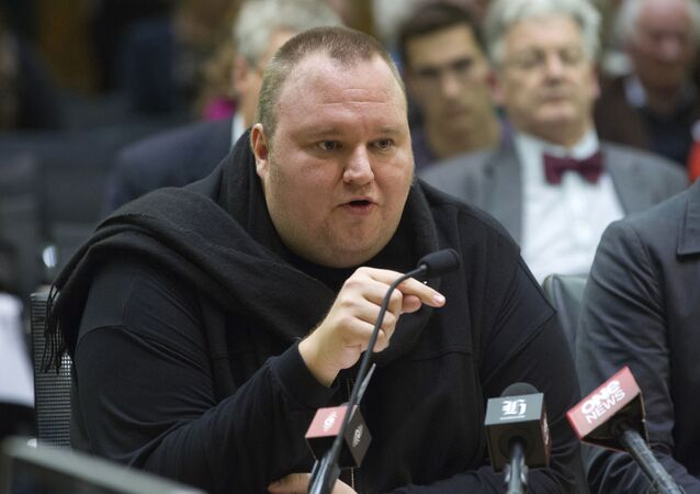 In this Wednesday, July 3, 2013 file photo, Internet entrepreneur Kim Dotcom speaks during the Intelligence and Security select committee hearing at Parliament in Wellington, New Zealand
