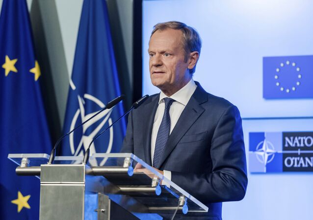 European Council President Donald Tusk addresses the media after the signature of the second EU NATO Joint Declaration, in Brussels on Tuesday, July 10, 2018