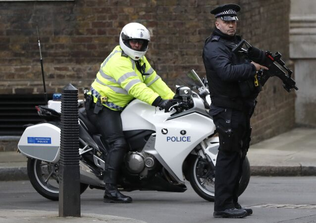 Police officers keep guard at Downing Street in London, Wednesday, Dec. 6, 2017.