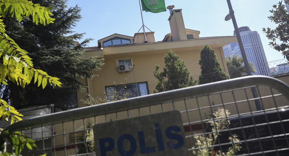 Turkish police barriers block the road leading to the Saudi Arabia consulate in Istanbul, Sunday, Oct. 7, 2018
