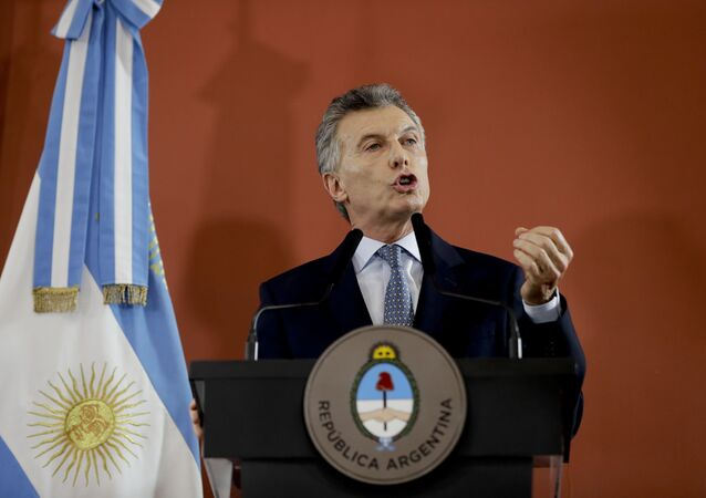 Argentina's President Mauricio Macri speaks from the government house in Buenos Aires, Argentina Thursday, Sept. 27, 2018.