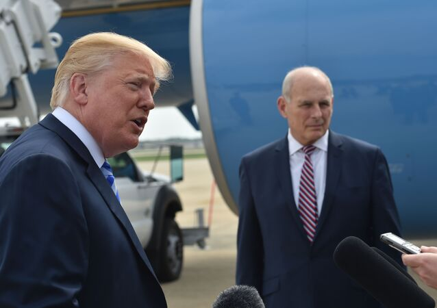 US President Donald Trump speaks to the press before making his way to board Air Force One on May 4, 2018 at Andrews Air Force Base, Maryland as he heads to Dallas, Texas to address the National Rifle Association Leadership Forum. Shown (C) is White House Chief of Staff John Kelly.