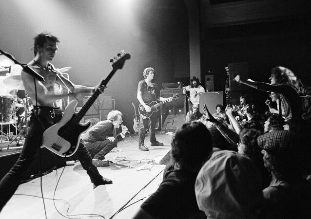 Sid Vicious (nearest to camera) on stage with Johnny Rotten and the other Sex Pistols in Memphis, Tennesse in January 1978