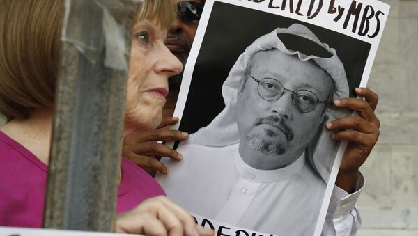 People hold signs during a protest at the Embassy of Saudi Arabia about the disappearance of Saudi journalist Jamal Khashoggi, Wednesday, Oct. 10, 2018, in Washington. - Sputnik International