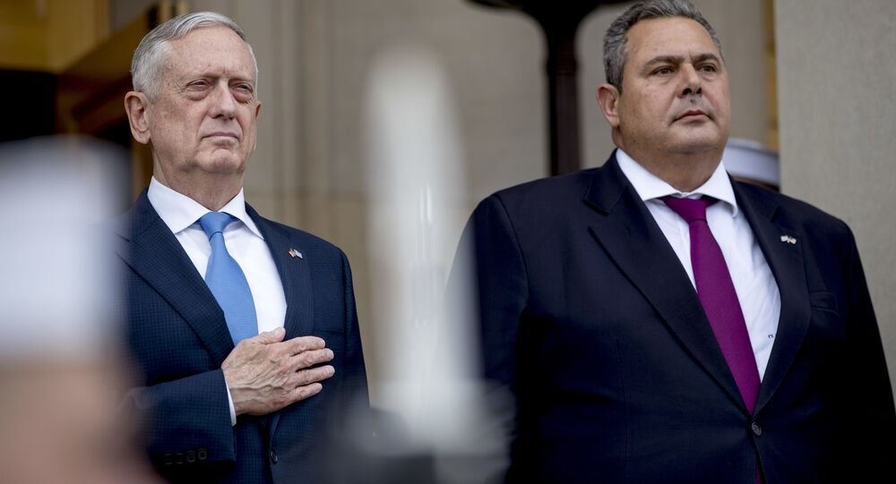 Defense Secretary Jim Mattis, left, and Greek Defense Minister Panagiotis Kammenos, right, stand as national anthems are played during an enhanced honor cordon at the Pentagon, Tuesday, Oct. 9, 2018, in Washington.
