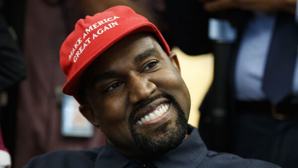 Rapper Kanye West smiles as he listens to a question from a reporter during a meeting in the Oval Office of the White House with President Donald Trump, Thursday, Oct. 11, 2018, in Washington. - Sputnik International