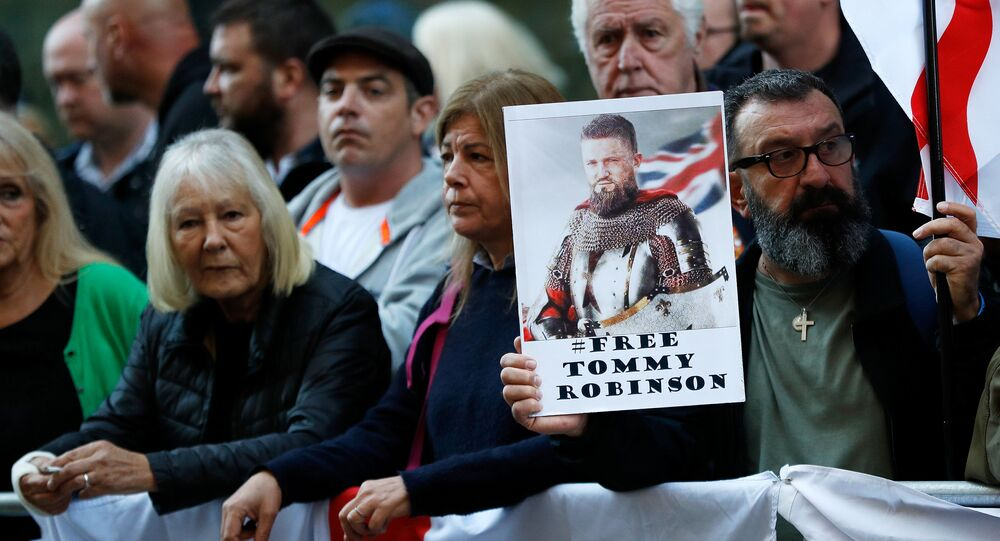 Supporters of former English Defence League leader Stephen Yaxley-Lennon, or 'Tommy Robinson', who was jailed for contempt of court in May and later released, wait for him to arrive at the Old Bailey to attend a court hearing, in London, Britain, September 27, 2018.