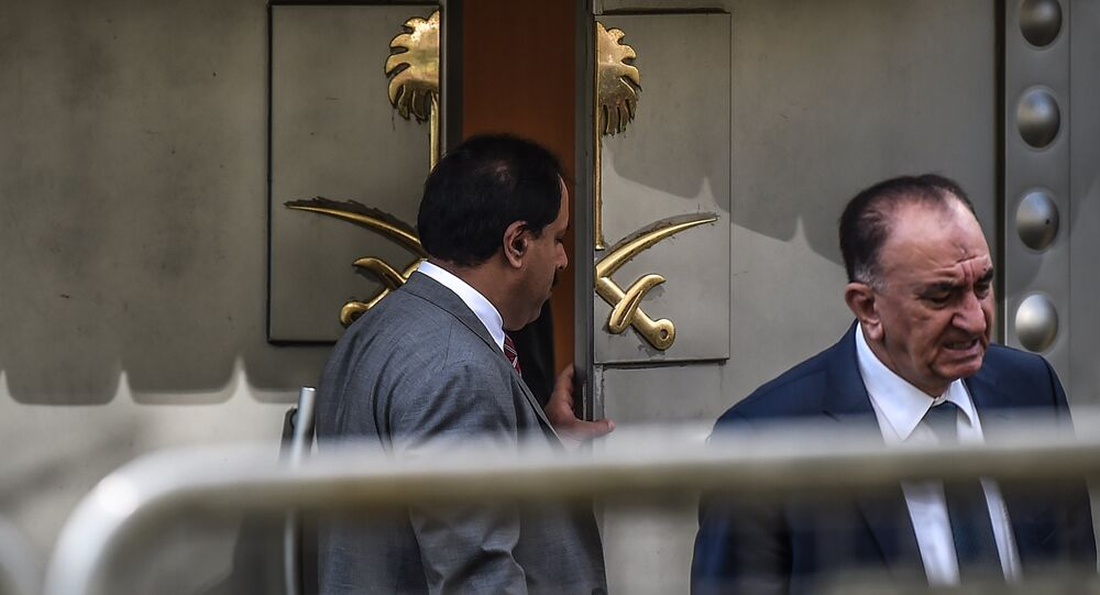 A Saudi official opens the door of the Saudi Arabian consulate in Istanbul on October 8, 2018 in Istanbul during a demonstration for missing journalist Jamal Khashoggi.