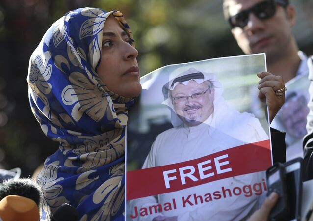 FILE - In this Friday, Oct. 5, 2018 file photo, Tawakkol Karman, the Nobel Peace Prize laureate for 2011 holds a picture of missing Saudi writer Jamal Khashoggi as she speaks to journalists near the Saudi Arabia consulate, in Istanbul, Turkey.