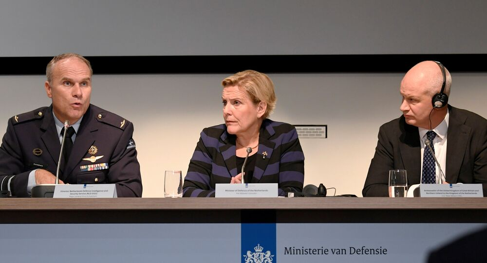 Dutch Minister of Defence Ank Bijleveld, general Onno Eichelsheim, director of Netherlands Defence Intelligence and Security Service and British Ambassador to the Netherlands Peter Wilson attend a news conference in The Hague, Netherlands, October 4, 2018