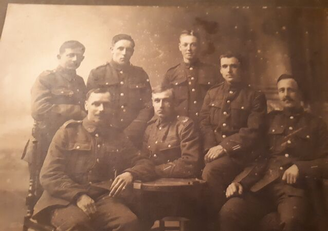 Private Sydney Feist (back row, far left) and his comrades in arms in the 9th Battalion, East Surrey Regiment in 1918