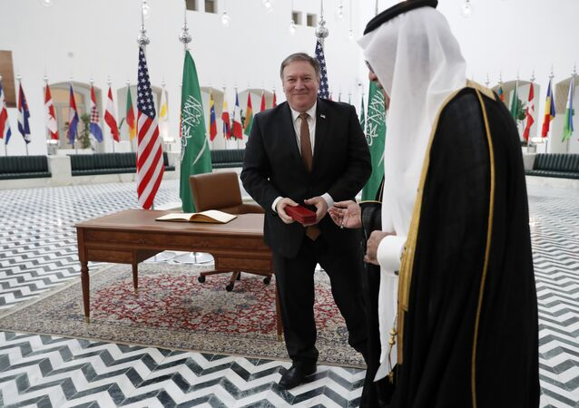 US Secretary of State Mike Pompeo receives a gift during a visit to the Saudi capital Riyadh, on October 16, 2018. Pompeo held talks with Saudi King Salman seeking answers about the disappearance of journalist Jamal Khashoggi, amid US media reports the kingdom may be mulling an admission he died during a botched interrogation.
