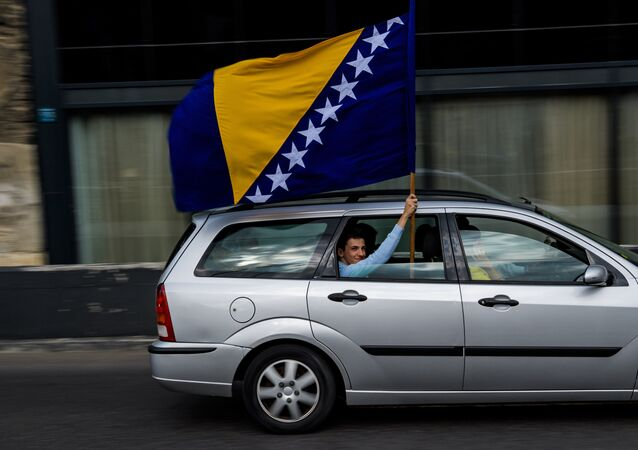 A man waves the Bosnian flag in Sarajevo on October 6, 2018 on the eve of Bosnian tripartite presidency election.