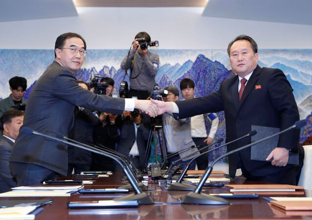 North Korea's Ri Son Gwon, chairman of the Committee for the Peaceful Reunification of the Country, shakes hands with South Korean Unification Minister Cho Myoung-gyon after exchanging the joint statement during their meeting at the truce village of Panmunjom inside the demilitarized zone, South Korea, October 15, 2018.