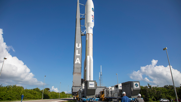 A ULA Atlas V rocket carrying the AEHF-4 mission for the U.S. Air Force is rolled from the Vertical Integration Facility to the launch pad at Cape Canaveral's Space Launch Complex-41. - Sputnik International