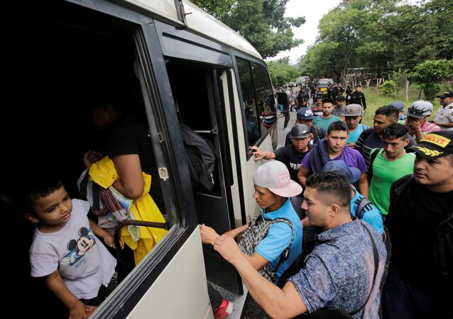 Honduran migrants board trucks sending them back to Honduras, after they crossed the border into Guatemala illegally in their bid to reach the U.S., in Agua Caliente, Guatemala October 17, 2018.