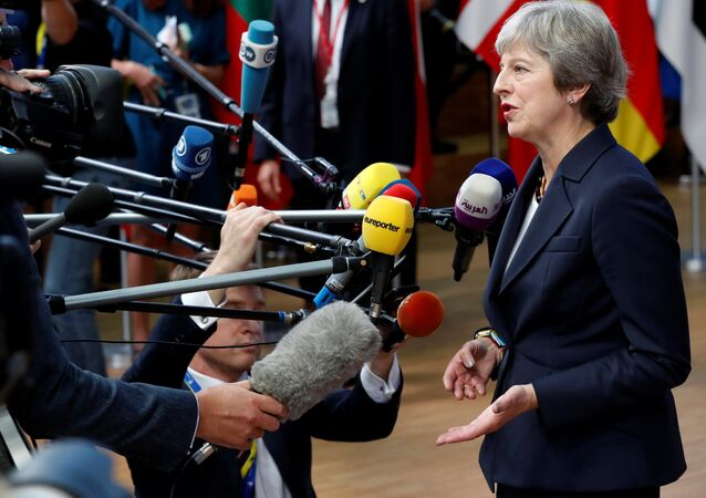 Britain's Prime Minister Theresa May arrives at an European Union leaders summit in Brussels, Belgium October 17, 2018.