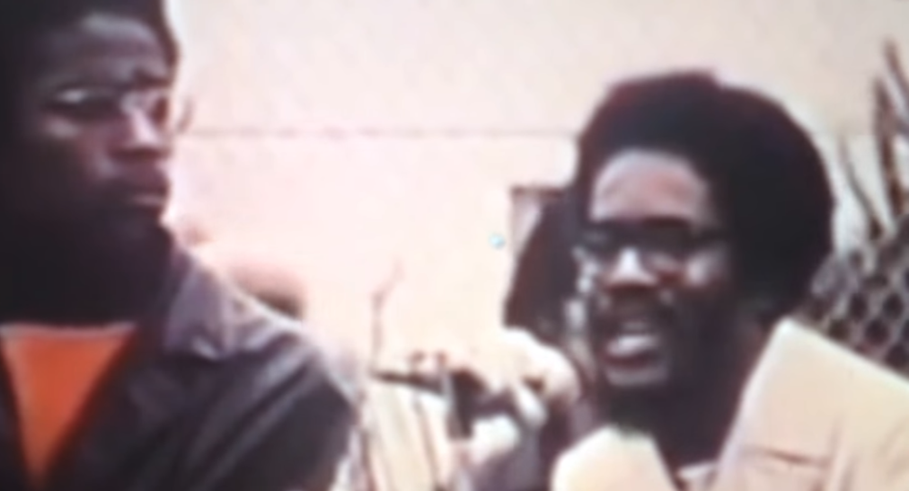 Walter Rodney, at right, speaks to a crowd in San Francisco, California, on African Liberation Day, May 25, 1972