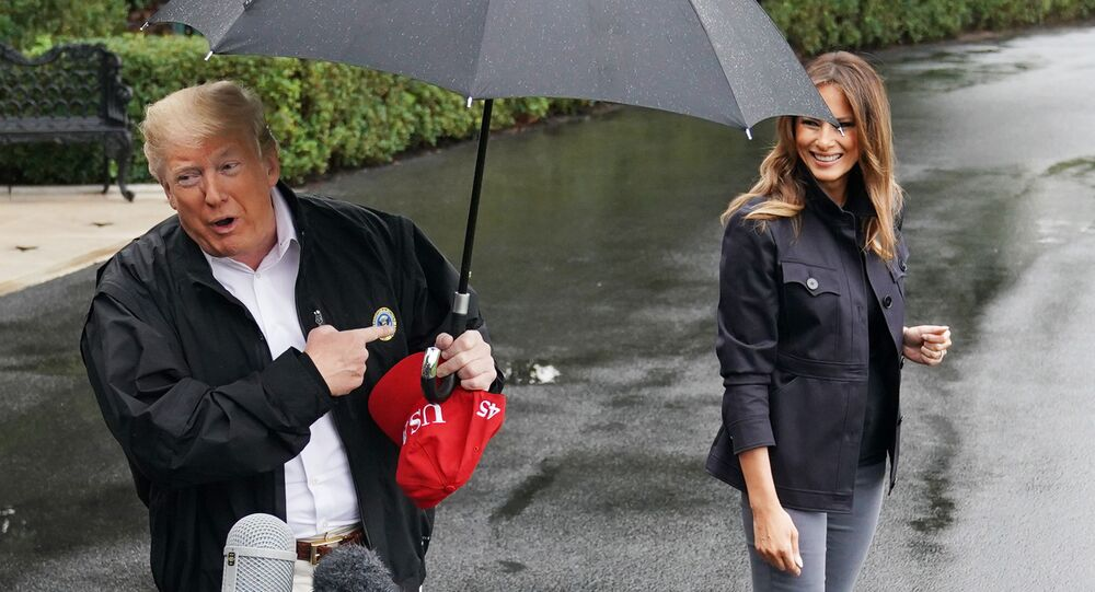 US President Donald Trump and First Lady Melania Trump make their way to board Marine One from the South Lawn of the White House in Washington, DC on October 15, 2018. - Trump is heading to Florida after Hurricane Michael devastated the state.