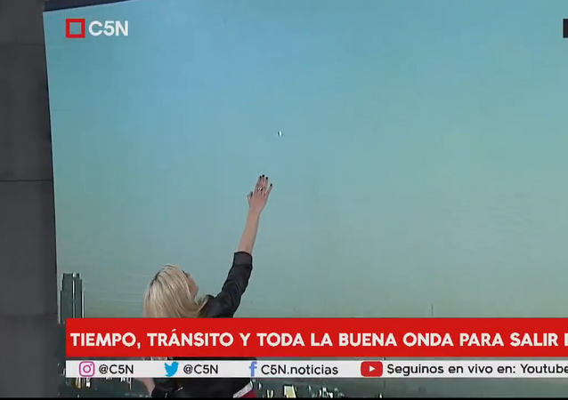 Metallic UFO Appears Live On Morning News Broadcast. Buenos Aires, Argentina