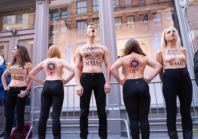 Topless PETA supporters braved the cold to take a stand against Canada Goose's cruelty to animals.