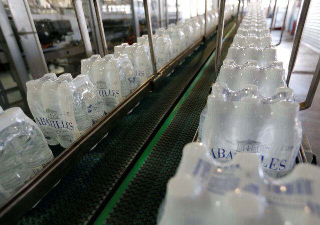 Plastic bottles of mineral water on the bottling line