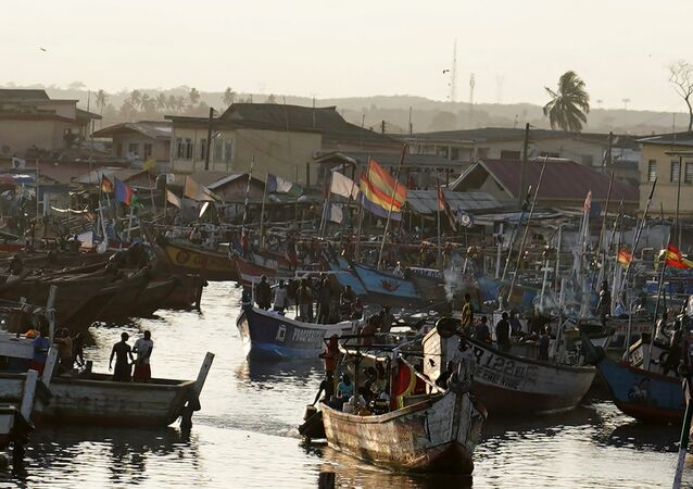 Fishing boats sit in the harbor as the motorcade that carries the media covering US first lady Melania Trump passes in Accra, Ghana, October 2, 2018.