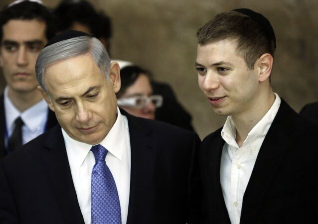 A picture taken on March 18, 2015 shows Israeli Prime Minister Benjamin Netanyahu (L) and his son Yair visiting the Wailing Wall in Jerusalem. The son of Israeli Prime Minister Benjamin Netanyahu faced online criticism on September 9, 2017 after sharing an image on his Facebook page deemed anti-Semitic by critics.