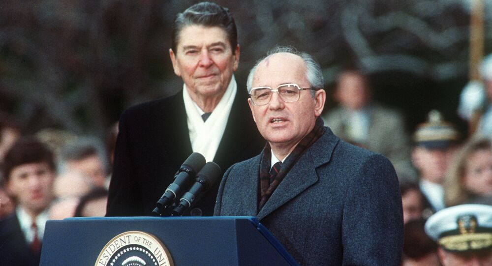 This photo shows US President Ronald Reagan (L) with Soviet leader Mikhail Gorbachev during welcoming ceremonies at the White House on the first day of their disarmament summit on December 8, 1987