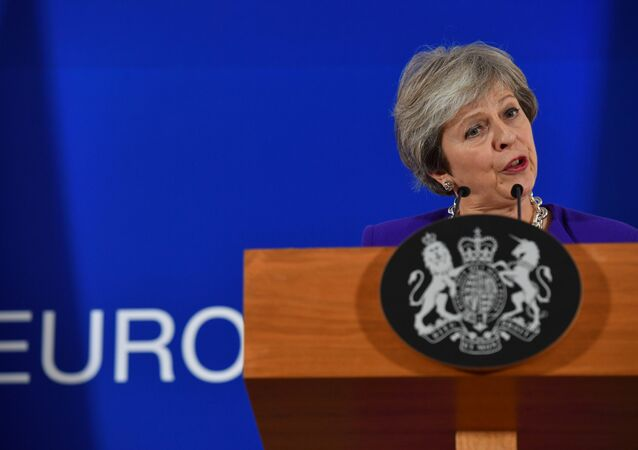 Britain's Prime Minister Theresa May addresses a press conference on the sidelines of a EU summit at the European Council in Brussels on October 18, 2018.