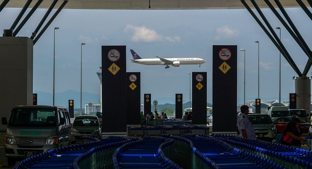 A Saudia Boeing 777 passenger aircraft makes its final approach for landing at the Kuala Lumpur International Airport (KLIA) in Sepang on August 20, 2015