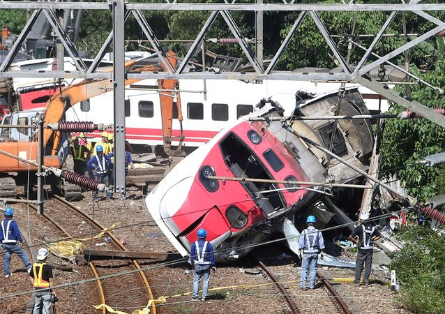Rescue workers work at the site where a train derailed in Yilan county, Taiwan October 22, 2018
