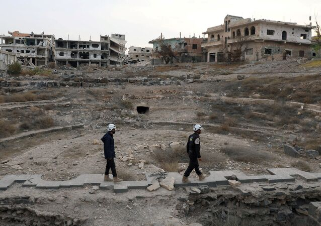 Members of the Civil Defence, also known as the 'White Helmets', are seen inspecting the damage at a Roman ruin site in Daraa, Syria (File)