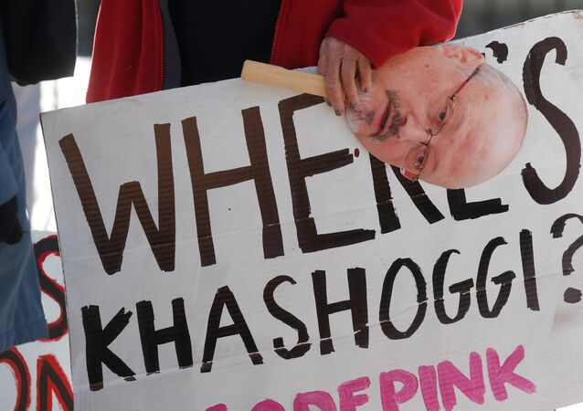 An activist holds a sign and image of missing Saudi journalist Jamal Khashoggi during a demonstration calling for sanctions against Saudi Arabia and to protest Khashoggi's disappearance, outside the White House in Washington, U.S., October 19, 2018