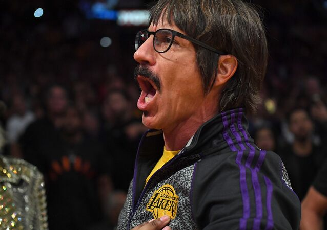 Anthony Kiedis, lead singer of the band Red Hot Chili Peppers, yells profanities at Houston Rockets guard Chris Paul (not pictured) as he is escorted off the floor after he was ejected from the fourth quarter of the game against the Los Angeles Lakers at Staples Center.