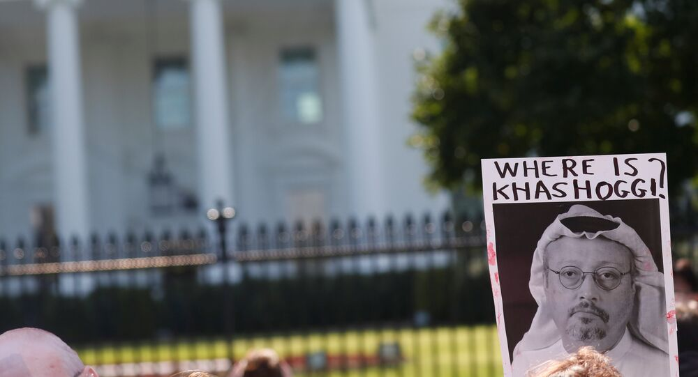 An activist holds an image of missing Saudi journalist Jamal Khashoggi during a demonstration calling for sanctions against Saudi Arabia