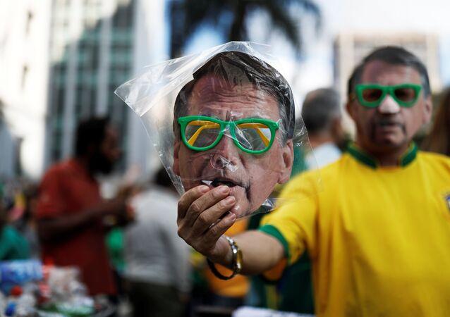 A street vendor sells a mask of Jair Bolsonaro
