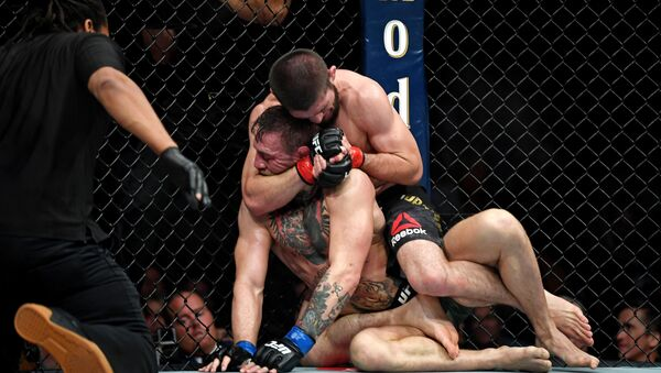 Oct 6, 2018; Las Vegas, NV, USA; Khabib Nurmagomedov (red gloves) fights Conor McGregor (blue gloves) during UFC 229 at T-Mobile Arena: - Sputnik International