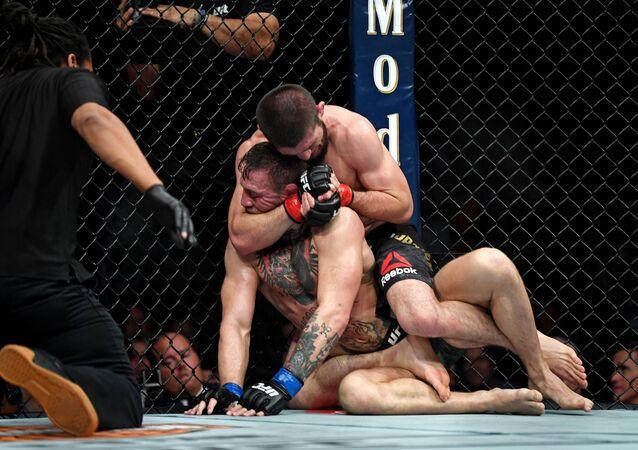 Oct 6, 2018; Las Vegas, NV, USA; Khabib Nurmagomedov (red gloves) fights Conor McGregor (blue gloves) during UFC 229 at T-Mobile Arena: