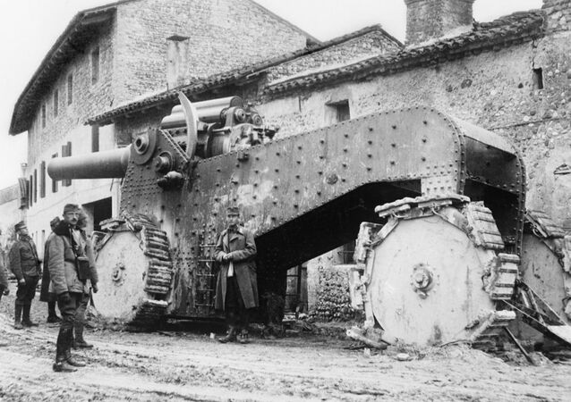 Austro-Hungarian troops examine a captured Italian howitzer in a village near Udine during the First World War