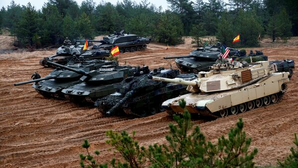 U.S., German, Spanish and Polish troops of the NATO enhanced Forward Presence battle goups with their tanks get ready for the Iron Tomahawk exercise in Adazi, Latvia October 23, 2018 - Sputnik International