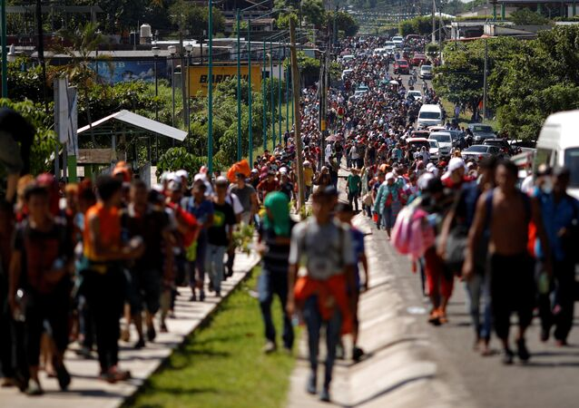 Central American migrants walk along the highway near the border with Guatemala, as they continue their journey trying to reach the U.S., in Tapachula, Mexico October 21, 2018
