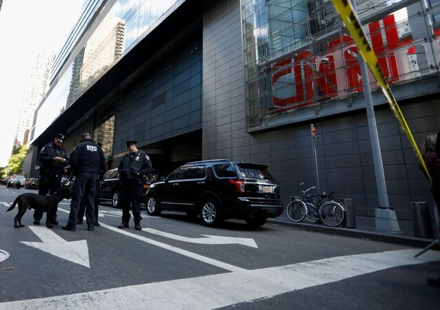 Members of the New York Police Department are seen outside the Time Warner Center after a suspicious package was found inside the CNN Headquarters in Manhattan