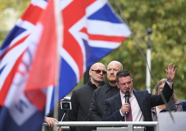Stephen Yaxley-Lennon (R), AKA Tommy Robinson, founder and former leader of the anti-Islam English Defence League (EDL), addresses supporters outside the Old Bailey, London's Central Criminal Court, in central London on October 23, 2018, after a case in which he is charged with contempt of court was referred to the attorney general.