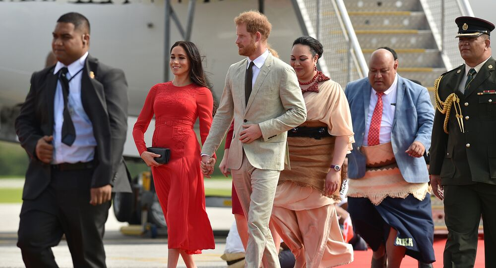 Britain's Prince Harry and his wife Meghan, Duchess of Sussex arrive at Fua'amotu airport in Tonga on October 25, 2018. Prince Harry and his pregnant wife Meghan left Fiji after a three-day official visit and arrived in Tonga as part of their tour of Australia and the South Pacific.