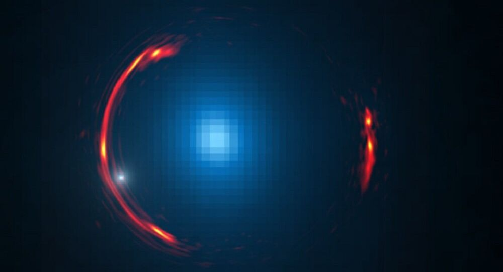 SDP.81 galaxy einstein ring with dark matter galaxy visible as a small white dot