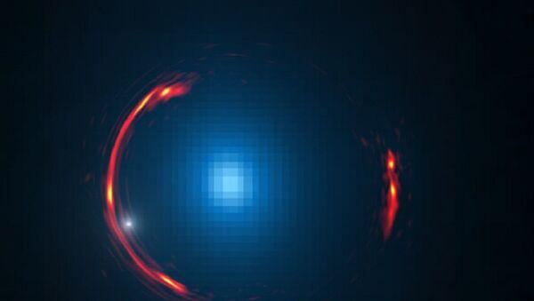 SDP.81 galaxy einstein ring with dark matter galaxy visible as a small white dot - Sputnik International
